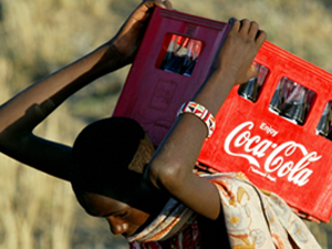 - PHOTO TAKEN 20DEC03  - A young Maasai carries a coca-cola bottle container before the graduation t..